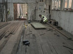 Laying the Studio floor at the Museum site.