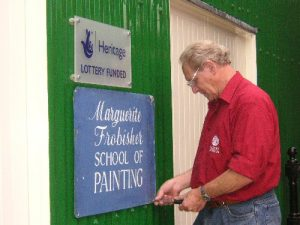 Finishing touches: adding the 'Frobisher School of Painting' sign at the Museum site.