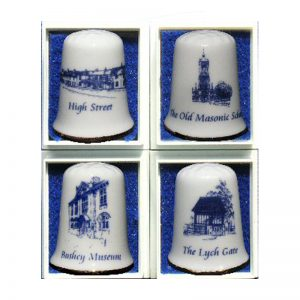 A set of four china thimbles with scenes of Bushey.