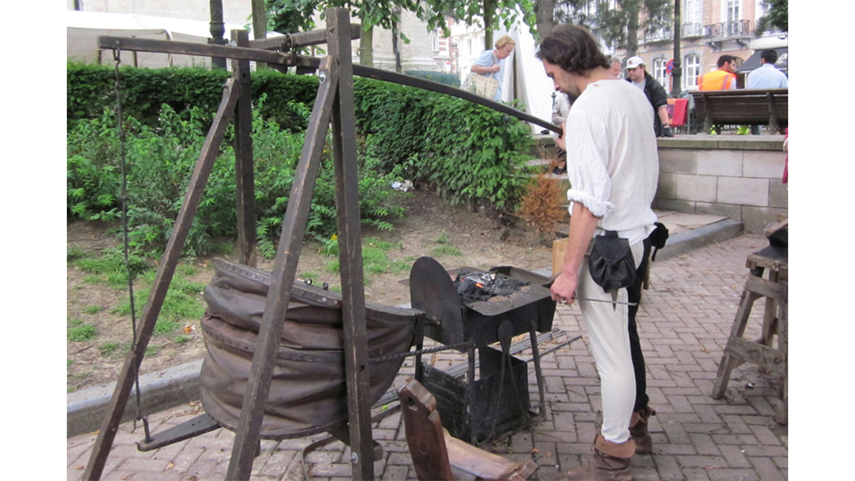 Blacksmith at Medieval Village Grand Sablon Brussels by Fred Parker
